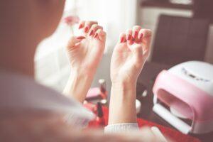 a woman checking nails