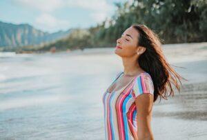 woman in the beach enjoying the sun