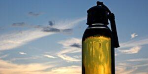 bottle of argan oil in a blue skin